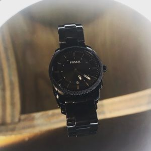 A used, jet black men's fossil watch